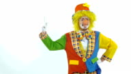 Portrait of amusing colorfully dressed clown counting on his fingers video