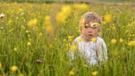 SLO MO Portrait of an adorable little girl in the grass video