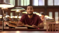 DS Portrait of African-American man studying in library video
