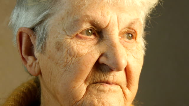 Portrait of an old woman. Close-up video