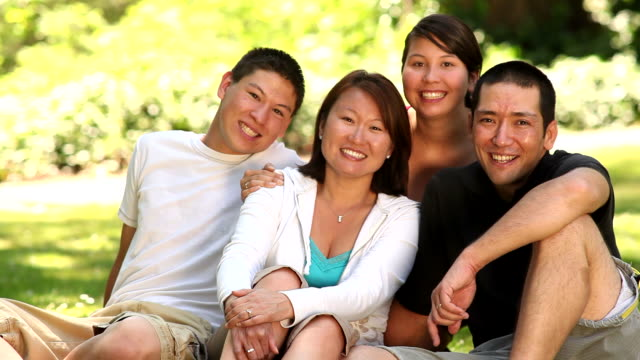 Portrait of Asian family in outdoor setting video