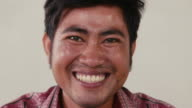 Portrait of Asian man looking at camera, people emotions video