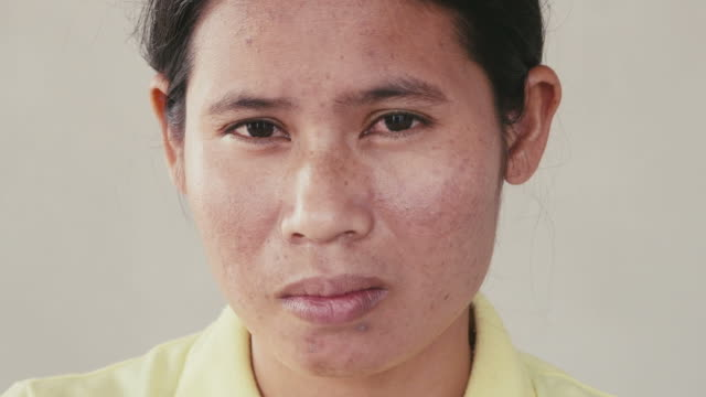 Portrait of asian woman looking at camera, emotions, feelings video