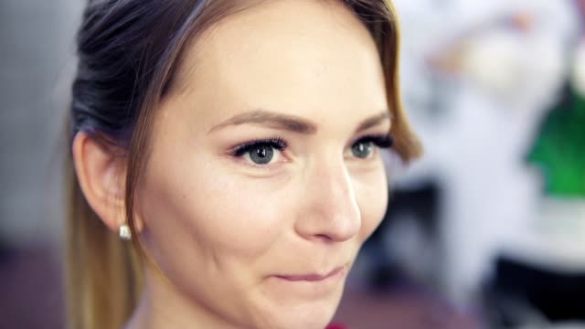 Portrait of attractive smiling caucasian ethnicity young woman. Slowmotion shot video