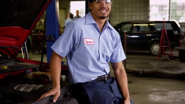 Portrait of auto mechanic in repair shop video