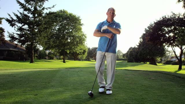 Portrait of baby boomer golfer video