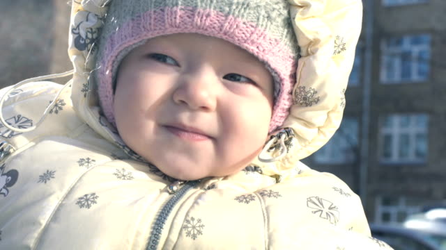 Portrait of baby girl in winter video