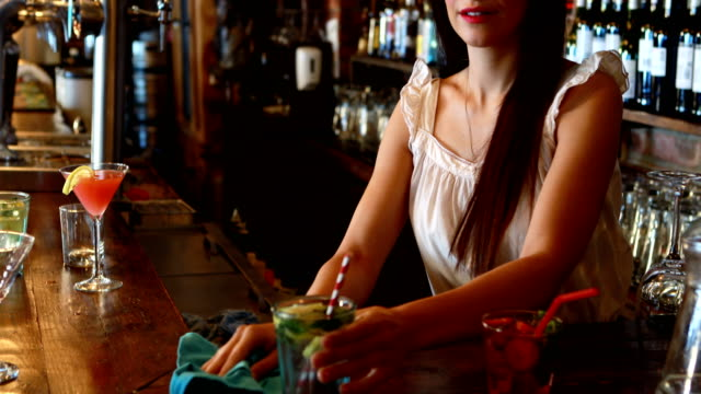 Portrait of barmaid cleaning bar counter video