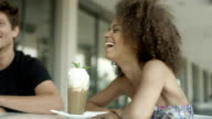 Portrait of beautiful young Afro American woman with friends at outdoor cafe. video