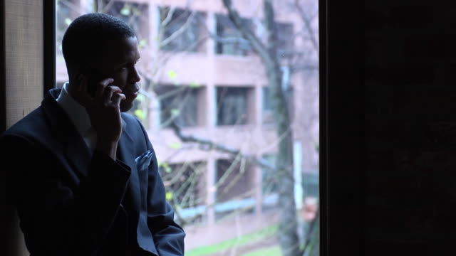 Portrait of Businessman on Cell Phone - MCU video