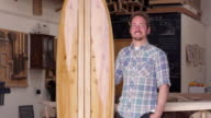 Portrait Of Carpenter With Surfboard Shot On RED Camera video
