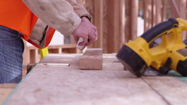 Portrait of construction worker measuring wood video
