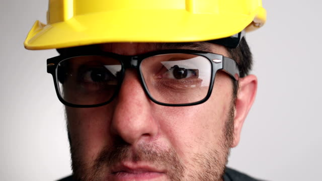 Portrait of construction worker on white background video