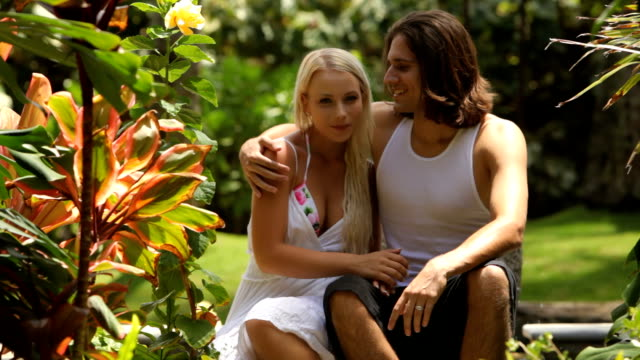 Portrait of couple in tropical outdoor setting video