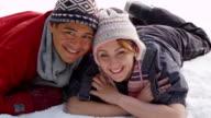 Portrait of couple in winter snow video