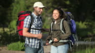 Portrait of couple with backpacks video