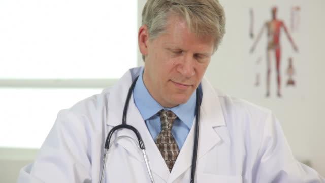 Portrait of doctor in office video