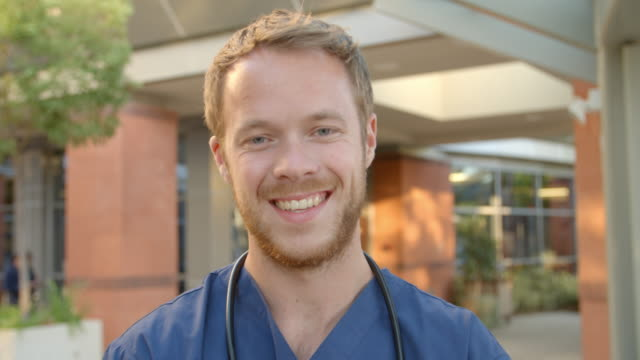 Portrait Of Doctor Standing Outside Hospital Shot On R3D video