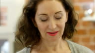 Portrait of elegant woman tries on an earring and look at the mirror video