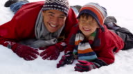 Portrait of father and son in winter snow video