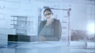 Portrait of female architect through her office glass wall video