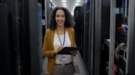 Portrait of female IT engineer in server room video