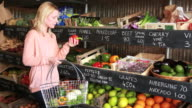 Portrait of Female shopping grocery in organic shop video