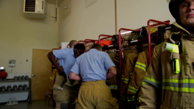Portrait of firefighter at station video