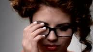 Portrait of girl in glasses  flirts video