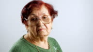 Portrait of grandmother with glasses, closeup view isolated on white video
