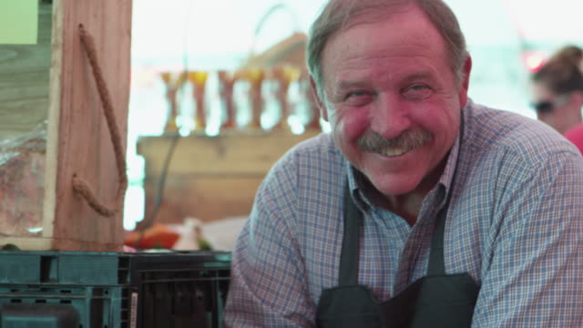 Portrait of grocery salesman video