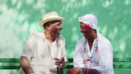 Portrait of happy old cuban black seniors smiling video
