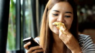 Portrait of happy woman have sandwich at cafe video