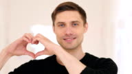 Portrait of Heart Sign by Happy YOung Man video