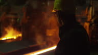Portrait of Heavy Industry Technician in Hard Hat in Foundry. Industrial Environment. video