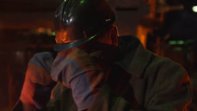 Portrait of Heavy Industry Technician Putting on Safety Glasses. Rough Industrial Environment. video