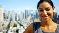 Portrait of Hispanic businesswoman on rooftop overlooking Manhattan video