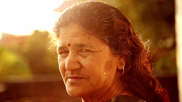 Portrait of Indian woman standing in the magic hour. video