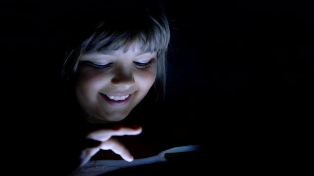 Portrait of Kid Using a Computer in the Night video