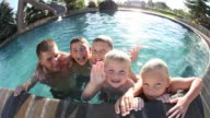 Portrait of kids in pool video