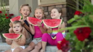 Portrait of kids with watermelon, dolly shot video