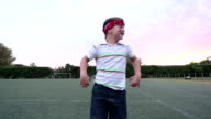 Portrait of little boy jumping and making angry faces video