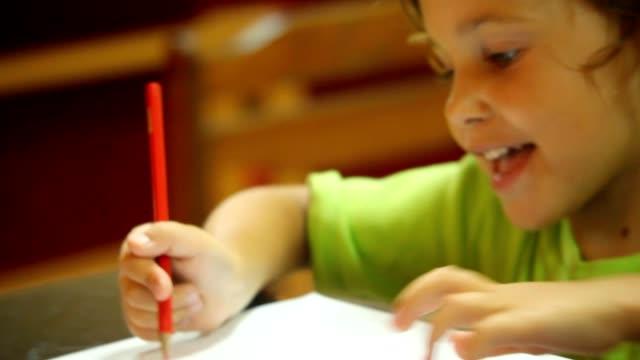 Portrait of little girl drawing pencils video