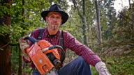 SLO MO Portrait of lumberjack holding a chainsaw video