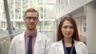 Portrait Of Male And Female Doctor In Hospital Reception video