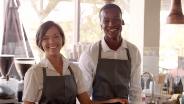 Portrait Of Male And Female Staff In Coffee Shop Shot On R3D video