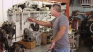 Portrait of man and mechanic shop video