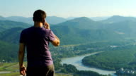 Portrait of Man talking on a mobile phone, Altai video