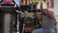 Portrait of man working on motorcycle video