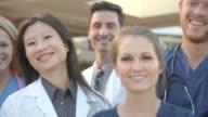Portrait Of Medical Team Outside Hospital Shot On R3D video